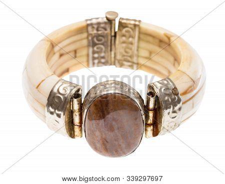 polished travertine stone insert in antique arabic camel bone bracelet isolated on white background stock photo