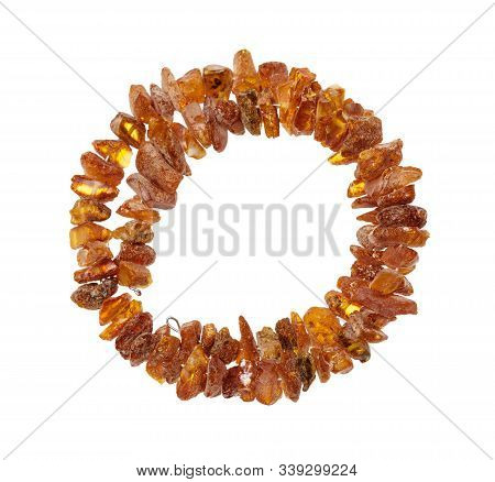top view of bracelet from natural rough amber nuggets isolated on white background stock photo