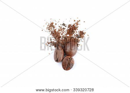 Coffee beans and powder isolated on white background, close up stock photo