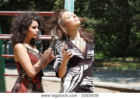 Laughing girls in garden happiness working outdoors stock photo