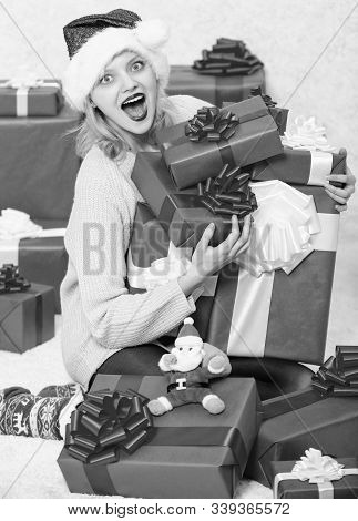 Girl near christmas tree happy celebrate holiday. Woman excited blonde hold gift box with bow. Perfect gift for girlfriend or wife. Opening christmas gift. Santa bring her gift that she always wanted stock photo
