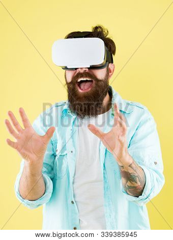Satisfaction enjoyment. Cyber sex. Virtual sexual activity. Man touch virtual breasts. Explore cybersex. Play virtual sex game. Intimate sensation concept. Hipster man play sex game hmd or vr glasses. stock photo