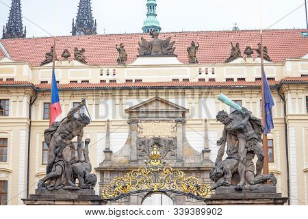 Entrance gate to the Prague Castle (Prazsky Hrad), with a detail on the statues of the Wrestling giants, also called sousosi souboj titanu, a major culture and landmark of the place. stock photo