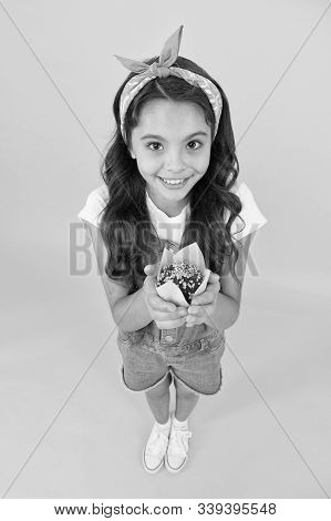 Made with love. Baked by me. Cute girl with freshly baked dessert food. Adorable child hold home baked muffin. Baked cupcake. Culinary skills. Muffin recipe. Little smiling kid with muffin. stock photo