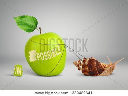 Impossible is possible concept, Snail pulling big apple stock photo