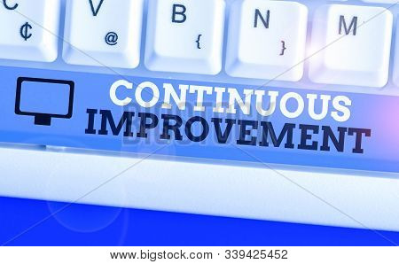 Handwriting text Continuous Improvement. Concept meaning ongoing effort to improve products or processes. stock photo