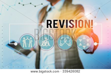 Handwriting text writing Revision. Concept meaning action of revising over someone like auditing or accounting. stock photo
