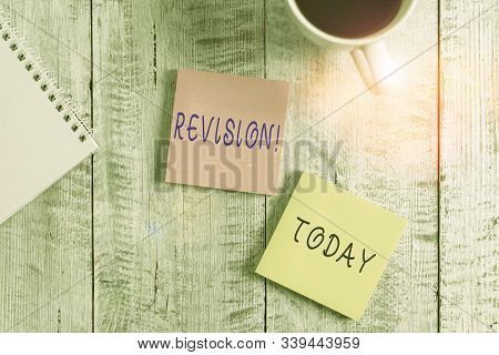 Text sign showing Revision. Conceptual photo action of revising over someone like auditing or accounting Stationary placed next to a cup of black coffee above the wooden table. stock photo