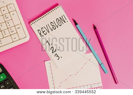 Handwriting text Revision. Concept meaning action of revising over someone like auditing or accounting Writing equipments and computer stuffs placed above colored plain table. stock photo