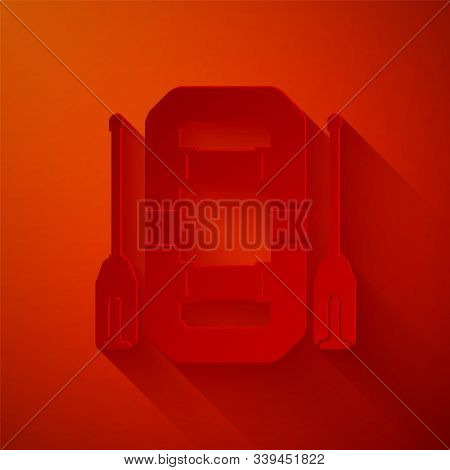 Paper cut Rafting boat icon isolated on red background. Inflatable boat with oars. Water sports, extreme sports, holiday, vacation, team building. Paper art style. Vector Illustration stock photo