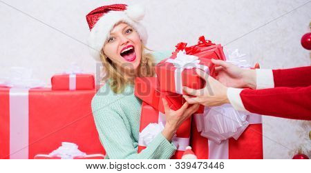 Perfect gift for girlfriend or wife. Opening christmas gift. Girl near christmas tree happy celebrate holiday. Santa bring her gift that she always wanted. Woman excited blonde hold gift box with bow stock photo