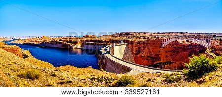 Panorama View of the Glen Canyon Dam with Lake Powell behind the dam, created by the Colorado River. Viewed from the Dam Overlook near Page, Arizona, United States stock photo