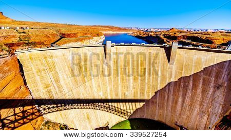 The Glen Canyon Dam with Lake Powell behind the dam, created by the Colorado River. Viewed from the Dam Overlook near Page, Arizona, United States stock photo