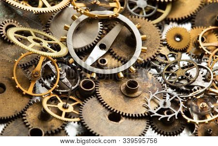 Vintage gears macro view. Aged mechanical clock wheels background. Shallow depth of field, soft focus. stock photo