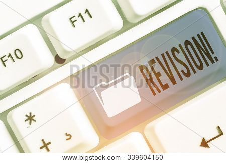 Text sign showing Revision. Conceptual photo action of revising over someone like auditing or accounting. stock photo
