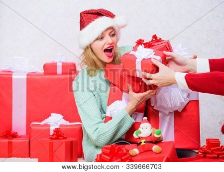 Woman excited blonde hold gift box with bow. Perfect gift for girlfriend or wife. Opening christmas gift. Girl near christmas tree happy celebrate holiday. Santa bring her gift that she always wanted stock photo