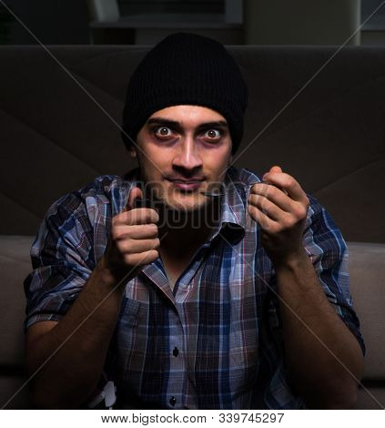 The young man in agony having problems with narcotics stock photo