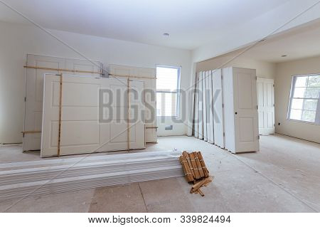 New home installing material for repairs in an apartment is under construction door for a under construction, remodeling stock photo