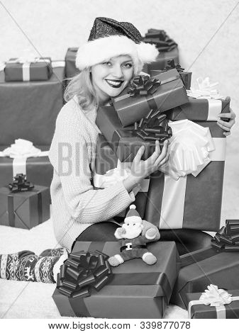 Woman excited blonde hold gift box with bow. Perfect gift for girlfriend or wife. Santa bring her gift that she always wanted. Opening christmas gift. Girl near christmas tree happy celebrate holiday stock photo