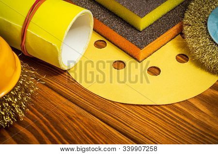 Set of abrasive tools and yellow sandpaper on vintage wooden background wizard is used for grinding items stock photo