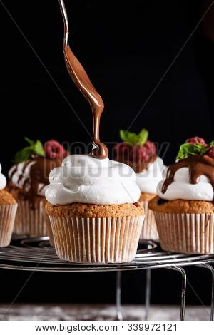 The process of baking delicious muffins with berries, white cream, chocolate. stock photo