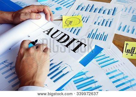 Audit report in the blue folder. Auditing concept. stock photo