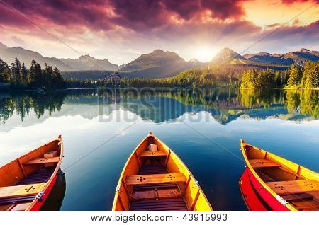 Mountain lake in National Park High Tatra. Dramatic overcrast sky. Strbske pleso, Slovakia, Europe.