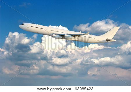 All white plane in the air in the clouds stock photo