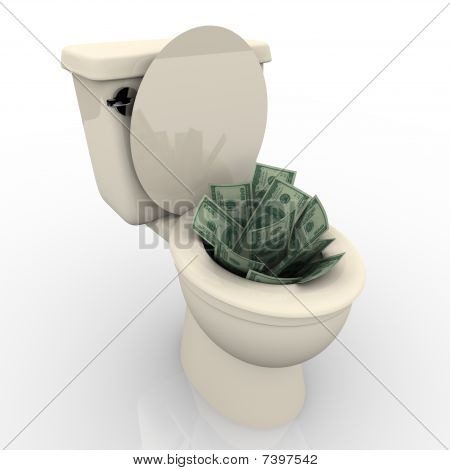 Several hundred dollar bills in a toilet bowl about to be flushed stock photo