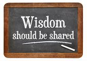 Wisdom ought to be share - moving content in white chalk on a vintage slate chalkboard