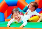 Happy Kids Having Fun On Playground In Kindergarten
