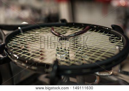 Racket stringing. Detail of tennis racket in the stringing machine stock photo