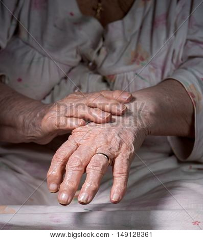 Close up of old wrinkled woman's hands stock photo