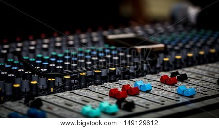 fader digital mixing console with volume meter volume indicator closeup stock photo