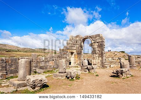 Volubilis near Meknes in Morocco. Volubilis is a partly excavated Amazigh then Roman city in Morocco situated near Meknes the ancient capital of the kingdom of Mauritania. stock photo
