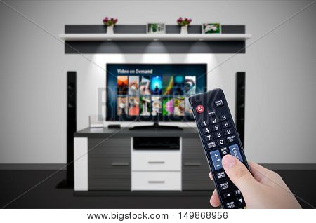 Video on demand VOD service in TV. Watching television home cinema tv hd concept stock photo