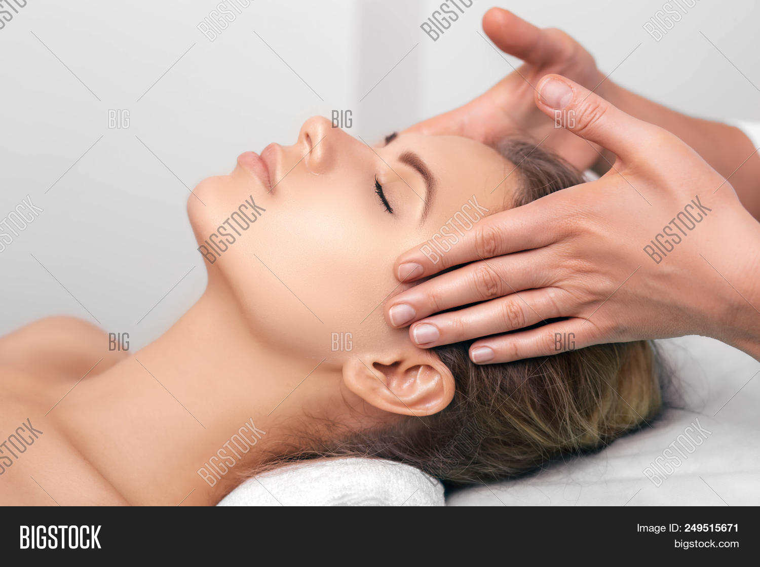 Young Woman Getting A Head Massage At A Spa. Face Massage With Perfect Clean And Fresh Skin