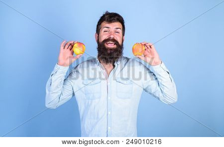 Apples antioxidant compounds responsible health benefits. Nutritional choice. Man with beard hipster hold apple fruit in hand. Apples popular type fruit in world. Nutrition facts and health benefits. stock photo