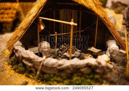 Miniature model of hut. Playing toy for a kid. Hut playset for kids. Mini hut for display. Realistic hut model. Model house. Wood house models for kids stock photo