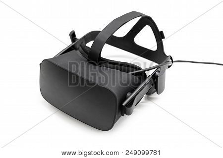 VR virtual reality headset half turned isolated on white background. Gaming future device, virtual reality glasses stock photo