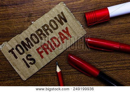 Word writing text Tomorrow Is Friday. Business concept for Weekend Happy holiday taking rest Vacation New week Pen pencil cap board marker pointer text cardboard notice script idea stock photo