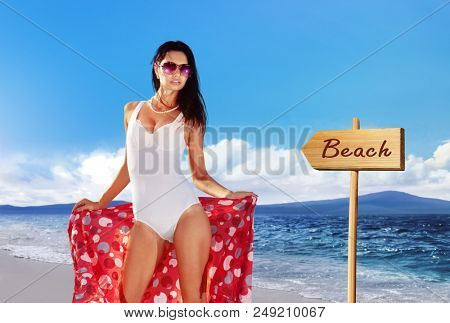 beautiful woman in a bathing suit derives pleasure and arrowhead to the beach stock photo
