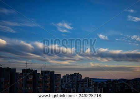 City silhouette against the puffy cloudy  sky on a sunset stock photo
