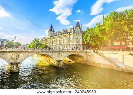 Pont au Change at sunset, bridge over river Seine and Conciergerie, a historic Parisian building within Palais de Justice complex, Ile de la Cite.Castle in former royal palace and prison Paris, France stock photo