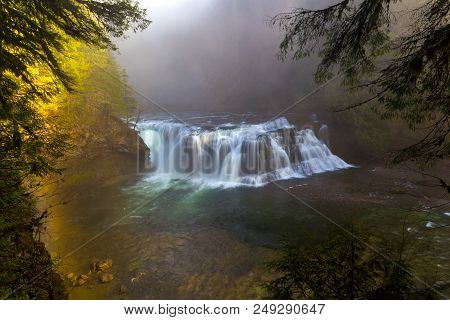 Foggy morning at Lower Lewis River Falls in Washington State stock photo