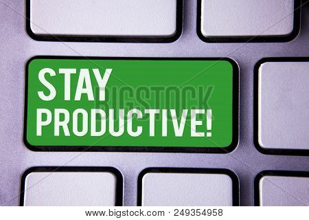 Handwriting text writing Stay Productive Motivational Call. Concept meaning Efficiency Concentration Productivity White Text two words green tab key button press computer keyboard work stock photo