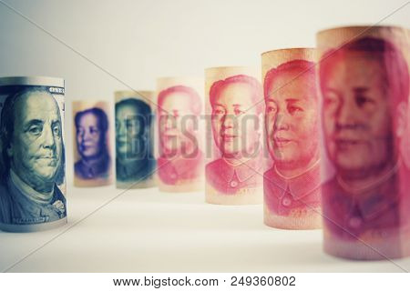 Face to face between Franklin and Mao. Serious tension trade war between USA dollar and China Yuan banknote which both country have increase tax for commerce tariff barrier crisis. stock photo