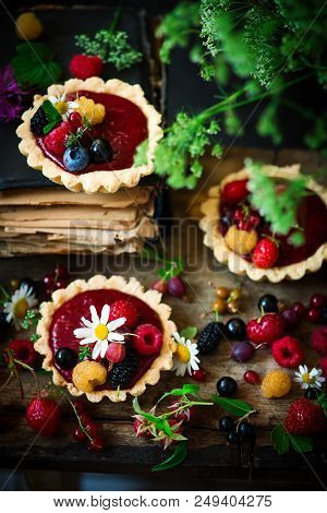 MIXED BERRY CURD TARTELETTES. rustic style.selective focus stock photo
