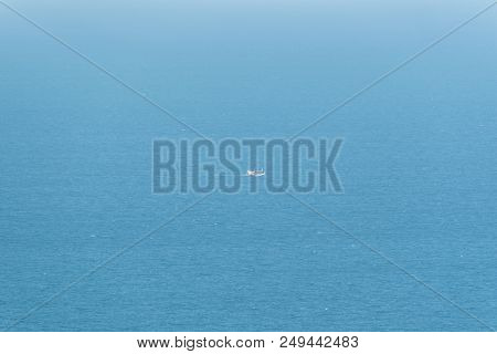Fishing boat is out fishing in blue sea or ocean for fishing industry by fishermen stock photo
