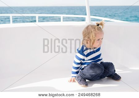 Kid friendly features. Family vacation cruise ship all inclusive tour. Kid boy toddler travelling sea cruise. Child in striped shirt looks like young sailor. Child enjoy vacation on cruise ship. stock photo